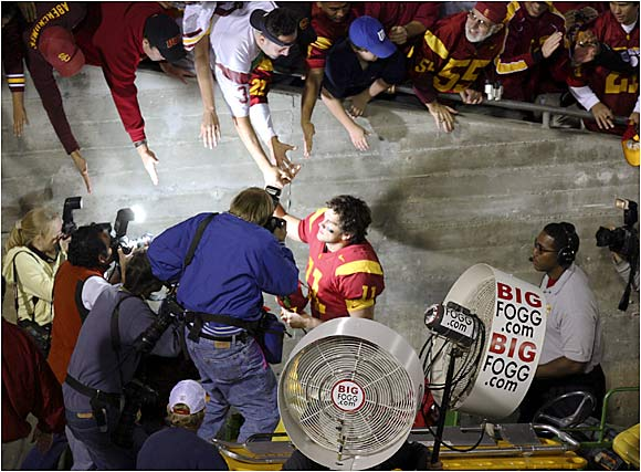 After beating UCLA, Matt Leinart is caught in a photographer's crosshairs as he shakes hands with fans on his way to the locker room.