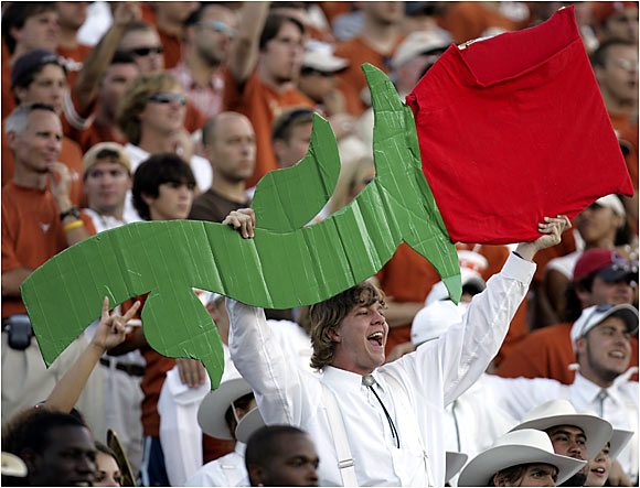 During an early-season game against Texas Tech, a Longhorns fan lets the crowd know what Bowl game she'd like to see Texas play in.