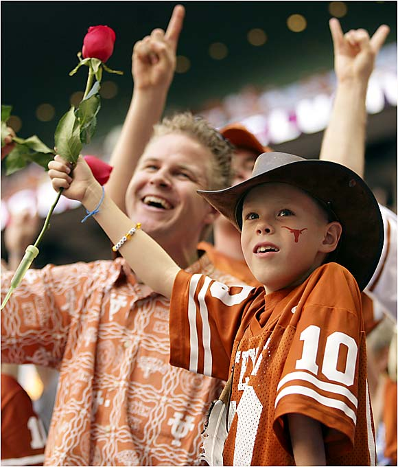 In the closing seconds of the Big 12 championship game, Texas fans wave roses in anticipation of the Longhorns' national championship game against USC.
