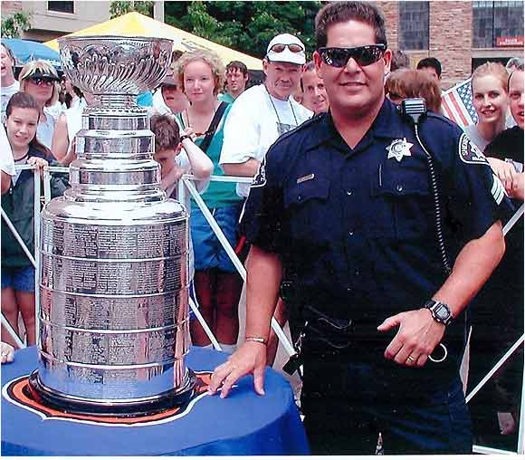 Here is the Cup at the 2002 Bolder/Boulder 10K run in Boulder, Colo. This was taken just outside Folsom field on the CU campus.  What an experience!!! -- Jeff Hendry, Personnel Sergeant, Boulder County Sheriff's Office