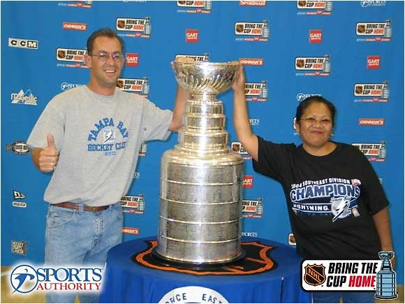 This photo was taken in Tampa about a month before the Tampa Bay Lightning won the Stanley Cup in 2004. My wife hates it because of the expression on her face -- she says she was laughing at me and wasn't ready for the picture to be taken.  It was the first time we had seen the Stanley Cup in person, and it was pretty awesome. -- Kevin Vacca