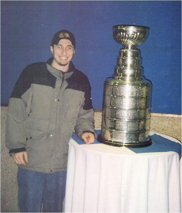 This is me with the Stanley Cup at the 2004 ECHL All Star game in Peoria, Ill., where I went to school at Bradley University. I got to meet Mike Bolt, the keeper of the Cup, and he's a very nice guy. He was nice enough to tell me and my friends all kinds of great stories about the Cup. Notice that I'm not touching the Cup in the picture. Even though I'll never have the chance to win it, as a purist, I refused to touch it because I didn't win it. Photographing myself with it was acceptable, however. -- Matt McClure