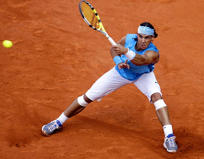 A year after Federer ended his 81-match winning streak on clay in this tournament final, Nadal collected a three-set victory.    Nadal leads series 10-6.