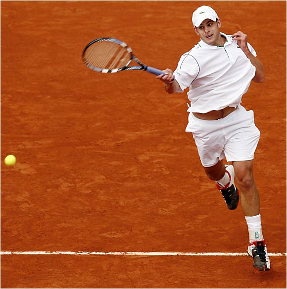 Andy Roddick's record at the French Open fell to 4-6 as he retired with an injured left ankle on Tuesday.