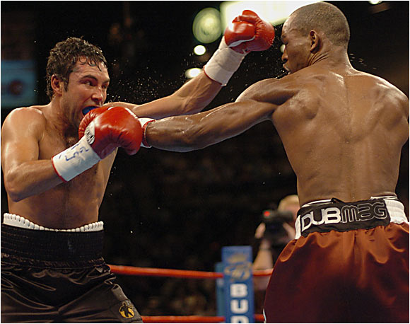 "Call Hopkins the anti-Oscar -- launched not by Olympic success but by a youthful stretch in Pennsylvania's Graterford Prison, driven not by crossover celebrity hype but by a stubborn insistence on doing it his way. Hopkins, at nearly 40, was making the 19th defense of his middleweight title (an earlier one had resulted in a 12th-round TKO of Felix Trinidad). In the end he was simply too big and too strong for De La Hoya, finishing him in the ninth round with a vicious left hook to the body. ""You want to get up,"" said a distraught De La Hoya afterward. ""You just can't."""