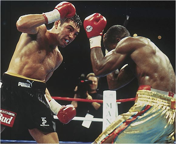 A five-time world champ who had earned more than $75 million in the ring, De La Hoya had yet to be truly tested as a pro. The tough Quartey, nicknamed Bazooka, remedied that -- dropping De La Hoya in the sixth and spearing him with jabs throughout. With the fight on the line in the final round, the Golden Boy proved his mettle, knocking Quartey down and battering him until the closing bell to win a split decision.