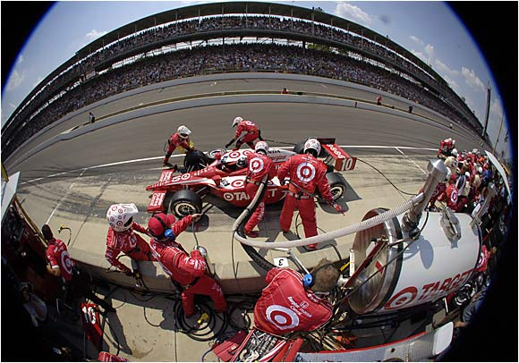 Defending champion Dan Wheldon gets refueled during a pit stop.