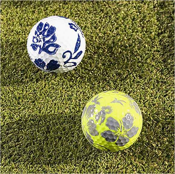 Hawaiian-print golf balls given to him by a marshal behind the 7th hole at the Sony Open.