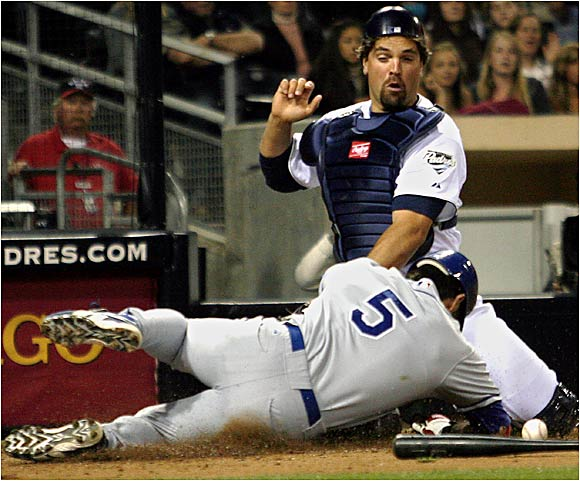 The Dodgers' Nomar Garciaparra crashes into Padres catcher Mike Piazza, who couldn't hold on to the ball at home plate on Friday at Petco Park.