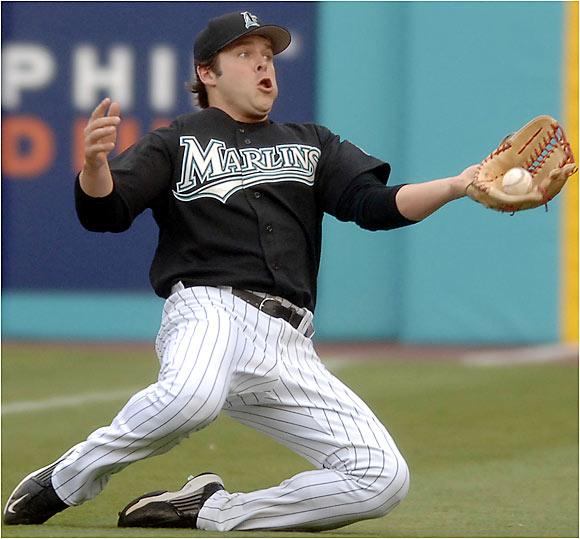 Florida right fielder Matt Cepicky makes a diving grab in foul territory to retire Colorado's Jamey Carroll on Saturday in Miami.