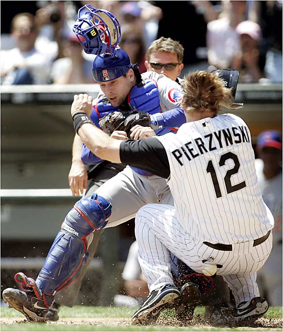 A.J. Pierzynski's hard slide into home ignited a melee between the Windy City rivals. Cubs catcher Michael Barrett responded to the slide by slugging Pierzynski in the jaw, and both benches cleared during the second inning of a Saturday-afternoon game in Chicago. Both Pierzynski and Barrett were ejected, and the White Sox rolled 7-0 at U.S. Cellular Field.