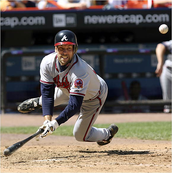 Braves pitcher John Smoltz hits the dirt against the Mets in New York on Sunday.
