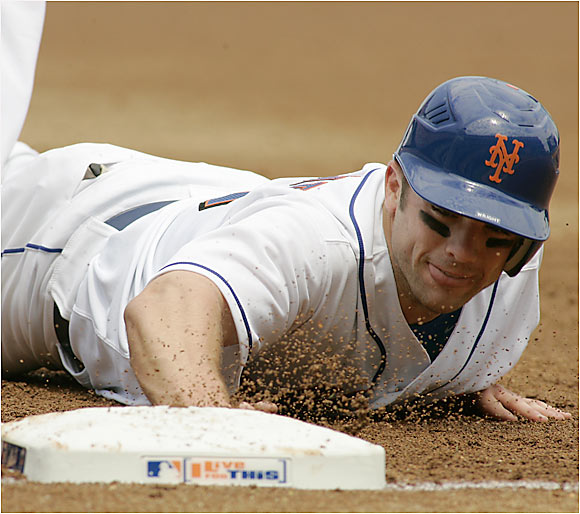 David Wright gets his uniform dirty against the Braves in New York on Saturday.