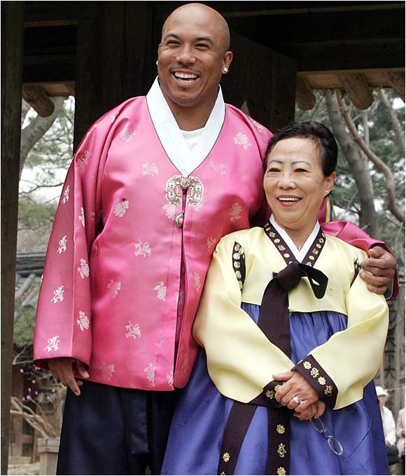 Super Bowl MVP Hines Ward poses with his mother, Kim Young-hee, as they wear traditional dress at the Korean Folk Village in Yongin, south of Seoul. The Pittsburgh Steelers receiver was given a red-carpet welcome as he arrived in the land of his birth amid intense media attention.