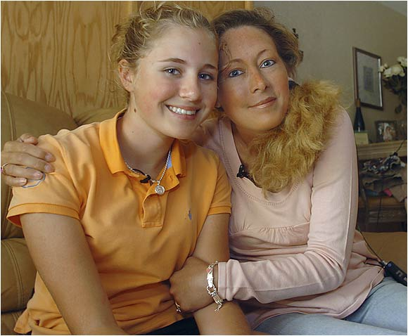 Dakoda Dowd sits with her mother, Kelly Jo Dowd, in their apartment in Palm Harbor, Fla. Dakoda was given an exemption to play in the LPGA Ginn Open in Orlando so that Kelly Jo, who has terminal cancer, could fulfill her wish of seeing her 13-year-old daughter play against the best women golfers in the world.