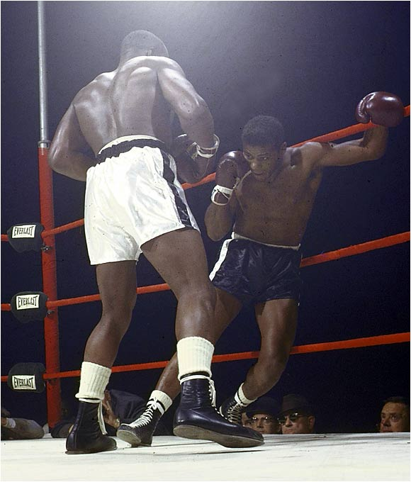 In a match promoted as nothing short of Good vs. Evil, Good (Patterson) weighed in at 189 pounds, Evil (Liston) at 214. That night in Chicago's Comiskey Park--as, perhaps, in life in general--it was no contest. Though employing his signature crouch and weave, Patterson couldn't evade Liston's jab (maybe the best in heavyweight history) and could not hold the bigger man off. Liston drove him into the ropes and finished him off with a thudding combination. The fight lasted two minutes and six seconds.