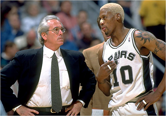 """Rodman: """"I think it's really stupid that you set me down and all of a sudden I don't start and I've got to take some pity minutes -- two or three here or there -- to get everybody's respect. I think that's really stupid. My respect is to go out there and do what I do best, and I do it well. All of a sudden you set me down like a kid and say, `Hey, you've got to start over again.' Damn, I've been in the league nine years. I know what to do.""""   Hill: """"If I were you guys [in the media], I would always listen very closely to Dennis, and then probably know that, whatever he says, the opposite is true. That's as honest as I can be."""""""