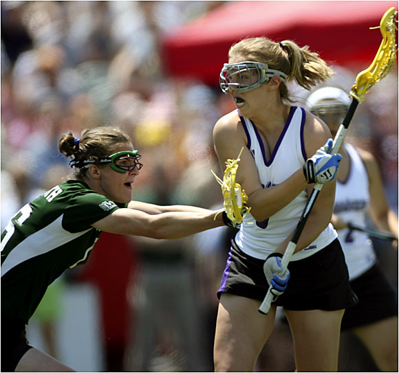 Lizzy Cuneo (left) and the Big Green played admirably in the school's first NCAA championship game, but Kristen Boege (6) and the Wildcats overwhelmed them with four goals in the final 23 minutes.