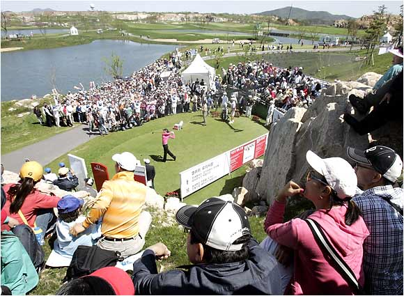 Teenager Michelle Wie was the focus of attention in South Korea last week -- and for the first time in eight tries, she made the cut at a men's pro event, eventually finishing 12 shots off the lead at the SK Telecom Open.