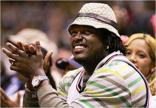 We're trying to take a break from showing you Beyonce and Jay-Z at Nets games, so instead we'll go with new Giants linebacker LaVar Arrington, who sported a hat that might make some Kentucky Derby attendees jealous.