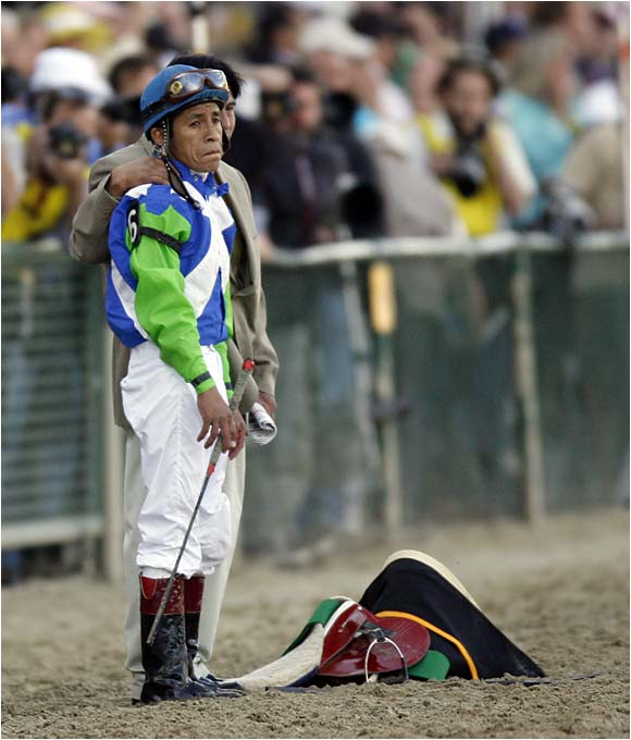 Barbaro jockey Edgar Prado is consoled after the race.