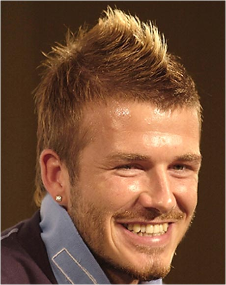"""Every new Beckham hairstyle sends acolytes flocking to salons across Europe and Asia hoping to Brush It Like Beckham. His most famous 'do was this """"fauxhawk"""" from the 2002 World Cup, in which the raised ridge down the middle was bleached with peroxide. The look was the brainchild of his wife, Victoria, the former Posh Spice."""