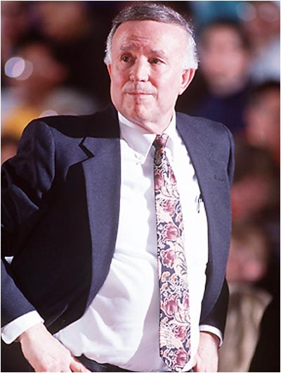 """The longtime college hoops coach's hairstyle, the """"Lou 'Do,"""" was memorialized in song during Illinois' 1989 Final Four run. Essentially, it was an ambitious comb-over that was held in place with what Henson admitted was the """"ultra, ultra hold spray."""" The Lou 'Do was also captured in a front-page 'Wall Street Journal' illustration for an article on the dying art of the comb-over."""