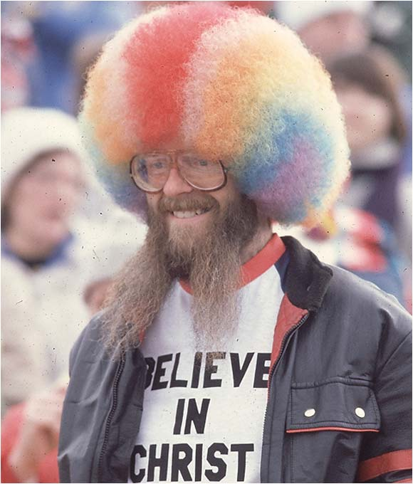 """The name might not ring a bell, but you probably recall the rainbow wig and """"John 3:16"""" sign of this '70s superfan. Alas, when the cheering stopped, Stewart took a maid hostage at gunpoint at a Los Angeles hotel in a nine-hour police standoff in 1992, demanding a televised press conference. He's currently serving a life sentence."""
