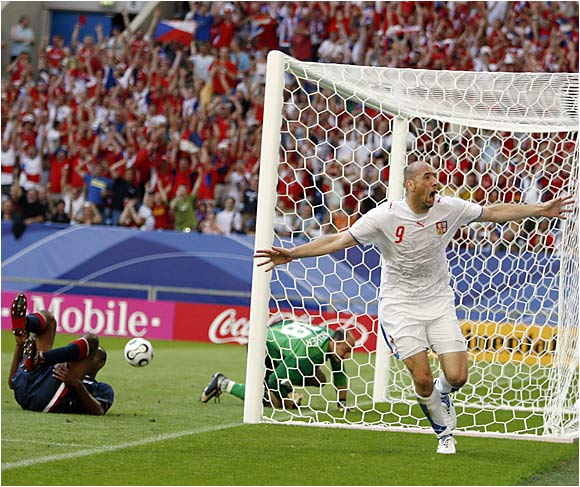 The 6-foot-7 1/2 Jan Koller celebrates his early goal, his 43rd in 69 international appearances.