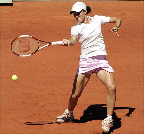 Serving at 4-3 and facing a break point, Justine Henin-Hardenne produced her first backhand winner of the match, 42 minutes in.