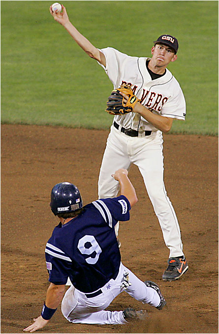 Oregon State's Chris Kunda tries to turn a double play during the Beavers 5-0 victory on Wednesday against Rice at Rosenblatt Stadium.