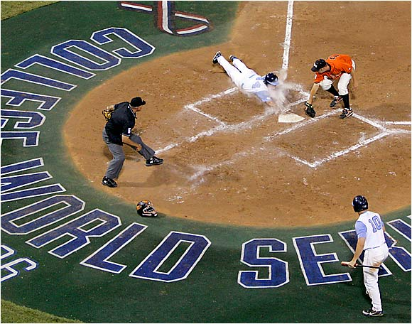 North Carolina first baseman Chad Flack scores the winning run in the eighth inning of Game 1.