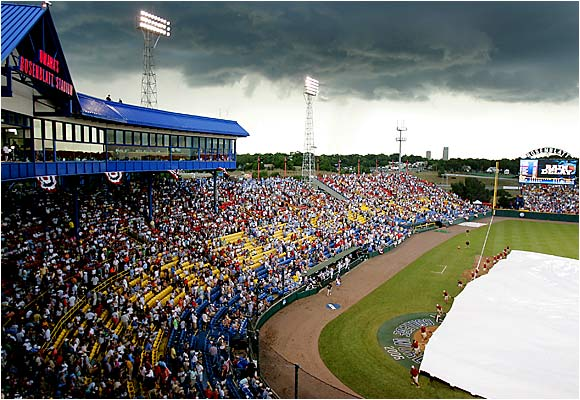 The Rosenblatt Stadium grounds crew had to cover the field on Saturday for what turned out to be a one-hour delay.