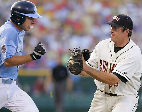 First baseman Bill Rowe chases down Carolina's Garrett Gore in the sixth inning.
