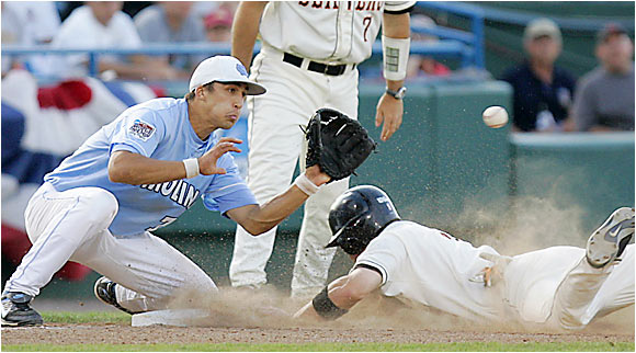 Oregon State third baseman Cole Gillespie slides safely into third during the Beavers' comeback win on Sunday.