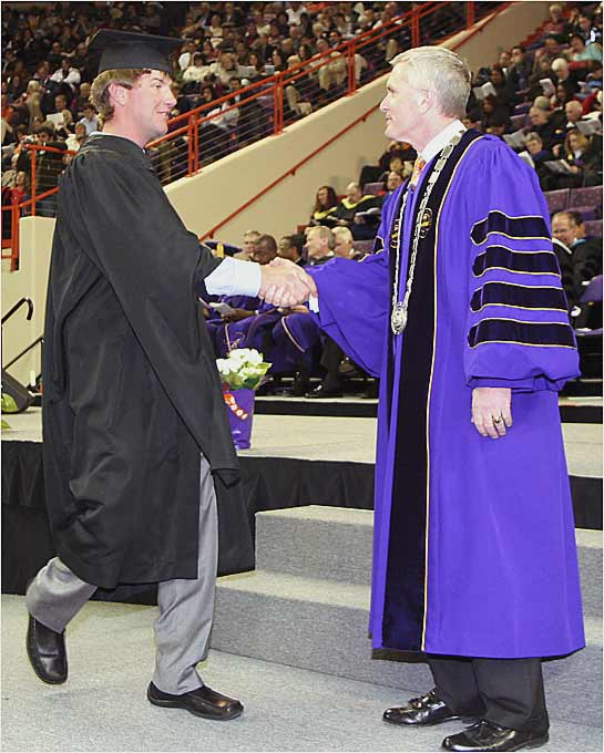 PGA Tour player and former Clemson University golfer Lucas Glover is congratulated by Clemson president James Barker during commencement in 2005.