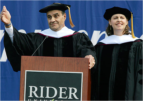 """Joe Torre celebrates with his wife after they both received honorary degrees during commencement ceremonies at Rider University. Said Torre of the honor, """"For a guy who struggled getting out of high school, it's great."""""""