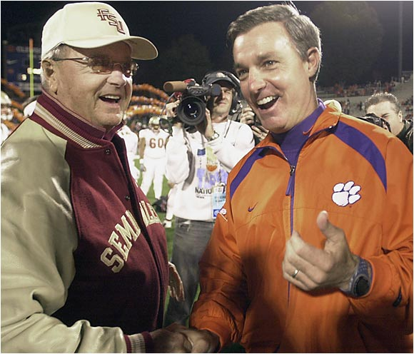 Florida State coach Bobby Bowden shakes hands with his son Tommy, coach of Clemson, at the start of one of their annual father-son Bowden Bowl matchups.