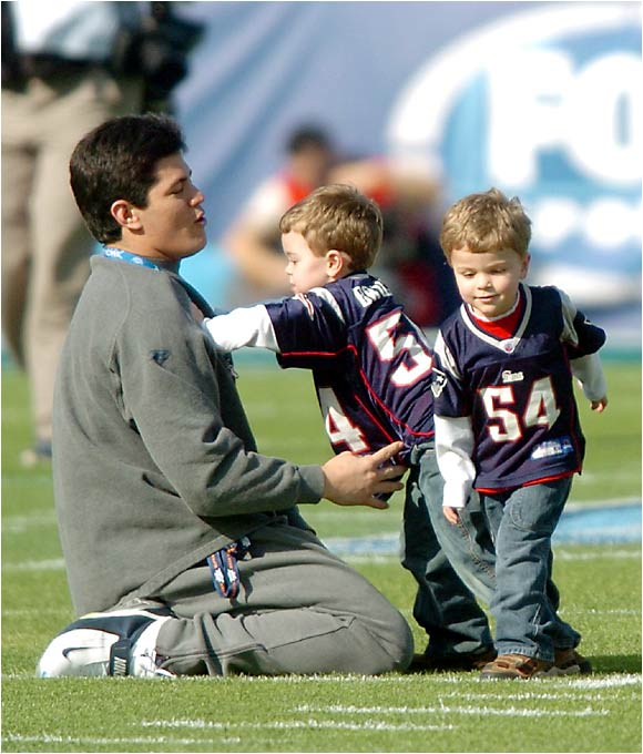 Tedy Bruschi enjoys a relaxing moment with his two sons before the 2005 Super Bowl. After winning his third championship in four years, Bruschi suffered an offseason stroke, but he returned to the field for the Patriots' 2005 season.
