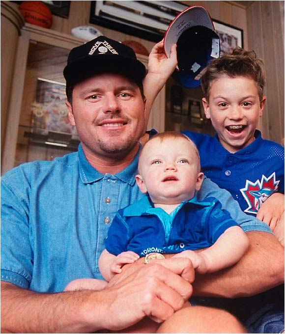 Roger Clemens relaxes at home with wife Debbie and sons Kody, Kory, Kacy and Koby before the 1997 season as the pitcher's then three Cy Young awards are displayed in the background. Koby was drafted in the eighth round of the 2005 MLB draft and hopes to one day catch a professional game pitched by his father.
