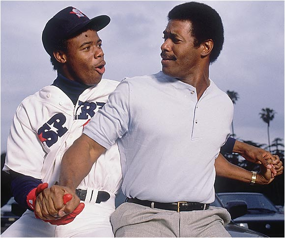 "Twenty-year-old Ken Griffey Jr., center fielder for the Class A San Bernardino Spirit, teases his 38-year-old father, Ken Griffey Sr. of the Atlanta Braves, in this March 1988 photo. After watching his son launch a 400-foot, three-run home run to win the game for the Spirit, Griffey Sr. told Sports Illustrated, ""It doesn't make sense for someone to have that much talent."""