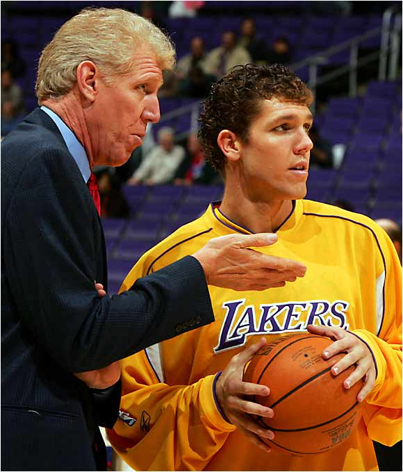 "Bill Walton gives some pointers to his son, Luke, before a November 2004 game. In an interview with SI, Luke complained about his father's penchant for giving bad gifts: ""I remember this one time, I had this heavy box. It was sitting under the Christmas tree for a while, so I was all excited. I opened it, and it was a big box of PowerBars."""