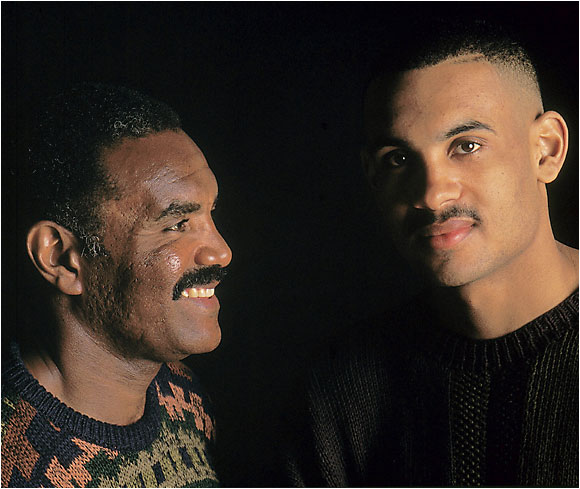 "Calvin and Grant Hill photographed together in January 1993, when Grant was a junior at Duke. Despite being one of the best college basketball players in the country, Calvin pointed out in an SI interview that his son hasn't let success go to his head: ""He's reluctant -- maybe too much so -- to stand out, to be perceived as better than others."""