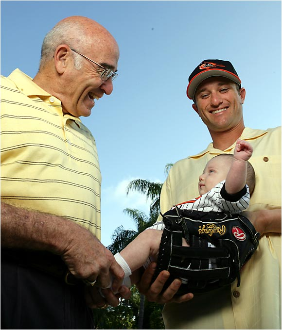 Baltimore Orioles utility infielder David Newhan and his father, Ross, share a moment during spring training in March 2005. The elder Newhan has been a baseball writer for three decades and was inducted into the Hall of Fame in August 2001.