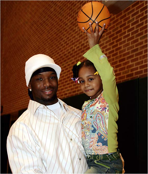 "Jermaine O'Neal poses for a picture with his five-year-old daughter, Asija. ""I believe in living my life the right way because I have a daughter and she looks up to me,"" O'Neal told SI last January. ""And I have fans that look up to me."""