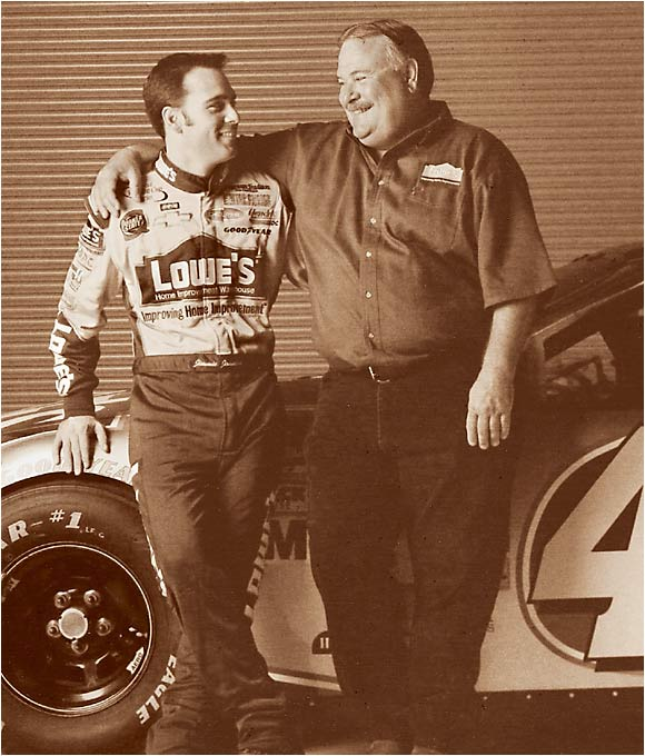 "NASCAR driver Jimmie Johnson poses with his father, Gary, in May of 2003. After working most of his life as a truck driver, Gary was hired by his son to drive the team's motor coach to each Winston Cup event. ""Driving for him means I get to go from track to track,"" Gary told SI. ""I couldn't have stood to watch his races on television -- that would have driven me crazy."""