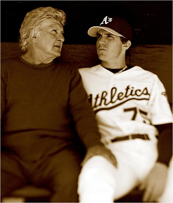 "Oakland A's pitcher Barry Zito and his father, Joe, in the A's dugout in June 2003, less than a year after Barry won the Cy Young Award. When asked how his dad has impacted his life, Barry told SI: ""I can't put into words what he means to me. It's like asking, 'What do your two legs mean to you?'"""