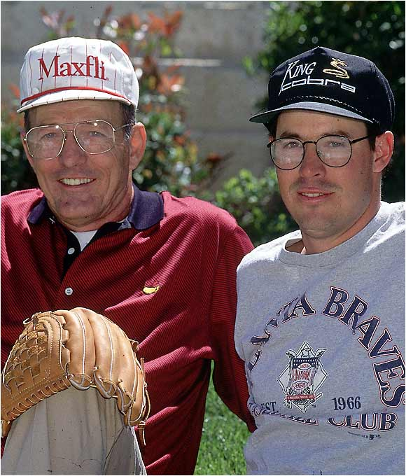 "Twenty-nine-year-old Greg Maddux sits with his dad, David, during a 1995 SI interview. Greg, fresh off winning three consecutive Cy Young Awards, refused to pose in front of his Cy Young trophies, saying: ""I've seen pictures like that. They always look so arrogant."""