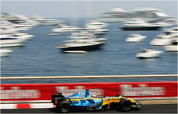Fernando Alonso's Renault reduces a fleet of boats to a mere blur during the Monaco Grand Prix in Monte Carlo on May 28. Alonso went on to his fourth victory in his first seven races of the season.