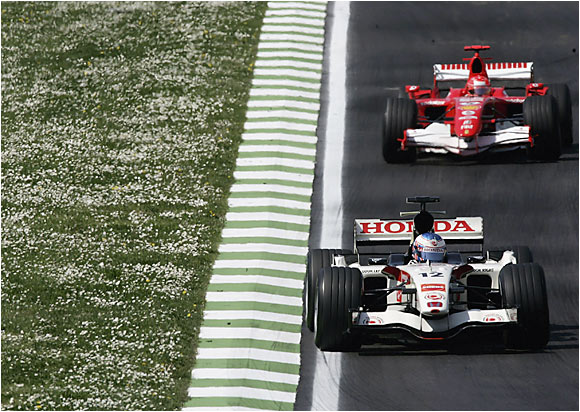 Michael Schumacher's Ferrari follows Great Britain's Jenson Button and his Honda during practice for the San Marino Grand Prix in Imola on April 22. Schumacher, the seven-time F-1 champion, later edges Fernando Alonso for his first win of the season.